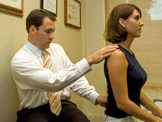 image of Dr French examining a patient's back pain